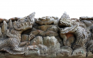 """King Of Nagas & Kylin Carving On Teak"" by kornnphoto"