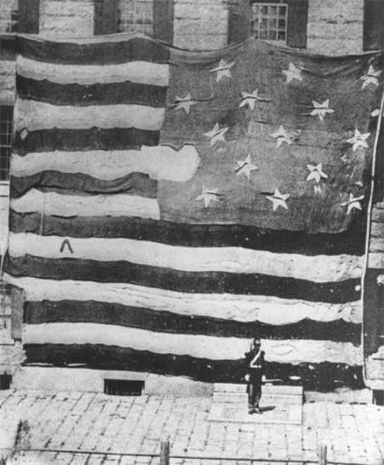This 1873 image is the first known photograph taken of the Star-Spangled Banner. Taken at the Boston Navy Yard on June 21st, 1873. (Courtesy of the American Antiquarian Society, Worcester, Massachusetts.)